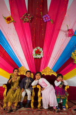 HMS1612774 India, Rajasthan state, Jodhpur, Children playing in the chairs of the future groom and bride before the official wedding ceremony
