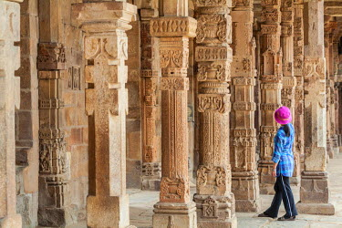 HMS2025268 India, New Delhi, Qutab Minar complex listed as World Heritage by UNESCO by UNESCO, Quwwat ul-Islam Mosque with its columns of the 13th century