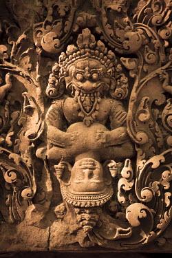 CM02078 Cambodia, Temples of Angkor (UNESCO site), Banteay Srei Temple, Narasimha (Vishnu avatara) clawing Hiranyakasipu