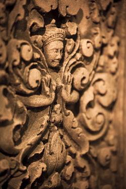 CM02079 Cambodia, Temples of Angkor (UNESCO site), Banteay Srei Temple, Narasimha (Vishnu avatara) clawing Hiranyakasipu