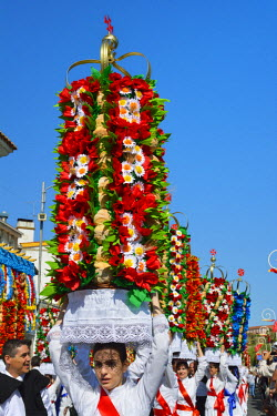 POR8348AW The Festa dos Tabuleiros (Festival of the Trays) in Tomar. This festival is an ancient tradition, and the most important celebrated in the city, attracting people from all over the world. People parad...