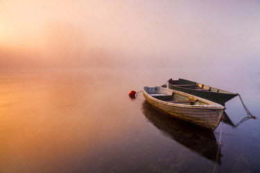 CLKGB18515 Brivio, Lombardy, Italy. Two boats on the Adda river at sunrise.