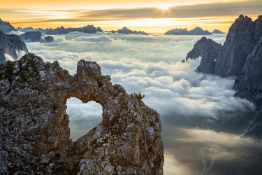 CLKMG8671 A rock's heart, on a cloud's sea, between rock walls. (Dolomites, Italy)