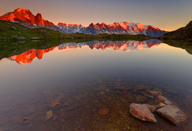 CLKMR206 Little alpine lake, reflecting the Mont Blanc massif, in the sunset (French alps)