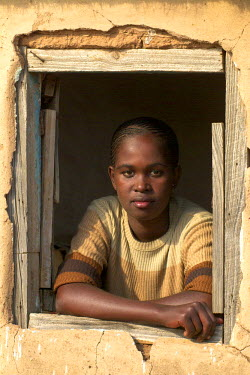 CLKRM5095 Girl appears at the window of her hut in a village of the Zululand in South Africa