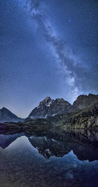 CLKRM14557 The milky way reflected in Lake Superior near Mount Monviso. Cozian Alps. Piedmont. Italy.