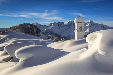 CLKRM16298 The huts and the bell tower at Alpe Scima covered in snow. Alpe Scima, valchiavenna, Lombardy, Italy.