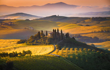 CLKST15960 Podere Belvedere, San Quirico d'Orcia, Tuscany, Italy. Sunrise over the farmhouse and the hills.
