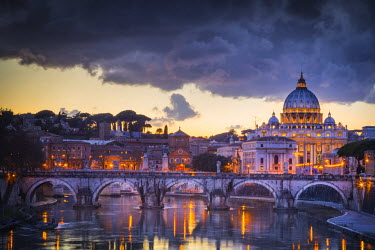 CLKST20784 Rome, Lazio, Italy. Sunset on Tevere River, with Saint Peter Cathedral on the background.