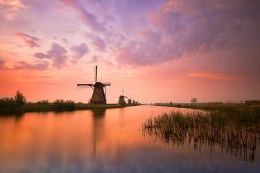 CLKWD10501 Kinderdijk, Netherlands The windmills of Kinderdijk resumed at sunrise.