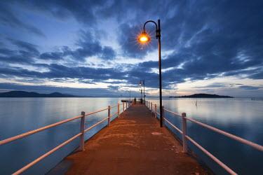CLKAD17529 Pier of Lake Trasimeno at dusk, Perugia, Umbria, Italy.