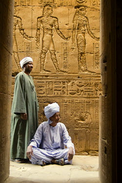 HMS0305195 Egypt, Upper Egypt, Nile Valley, Edfu, Egyptian men in the temple dedicated to Horus God