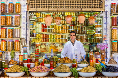 HMS2081850 Morocco, High Atlas, Marrakech, imperial city, medina listed as World Heritage by UNESCO, Souk El Khir, merchant of olives, vegetables and jars of condiments