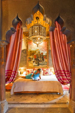 HMS2102230 Morocco, High Atlas, Marrakech, imperial city, Luxury Hotel La Sultana (5 stars), woman reading in his room