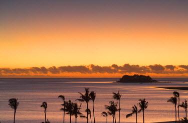 FIJ1057AW View of Wadigi Island at sunset, Mamanuca Islands, Fiji