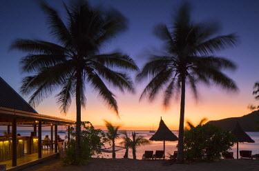 FIJ1094AW Bar at Octopus Resort at sunset, Waya Island, Yasawa Islands, Fiji