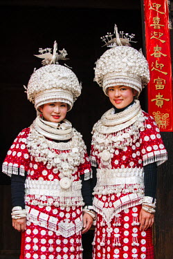 CH10489AW Young women of Miao minority wearing traditional costumes and silver jewellery, Guizhou, China