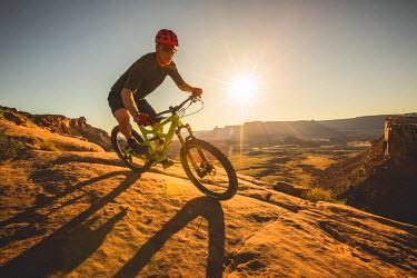 ARRIWI000261 A man mountain biking on the Captian Ahab trail, Moab, Utah.