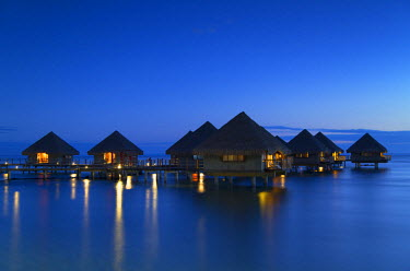 FPO0193AW Overwater bungalows at Le Meridien Tahiti Hotel at dusk, Pape'ete, Tahiti, French Polynesia