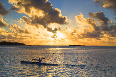 FPO0291AW Man kayaking at sunset, Hauru Point, Moorea, Society Islands, French Polynesia