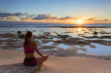 FPO0415AW Woman practicing yoga on beach at sunrise, Fakarava, Tuamotu Islands, French Polynesia (MR)