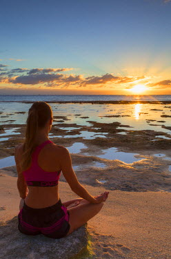 FPO0416AW Woman practicing yoga on beach at sunrise, Fakarava, Tuamotu Islands, French Polynesia (MR)