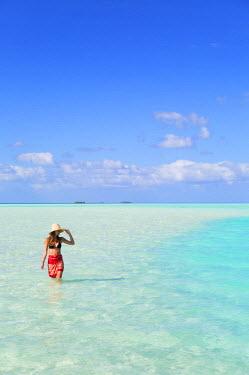 FPO0422AW Woman at Blue Lagoon, Fakarava, Tuamotu Islands, French Polynesia (MR)