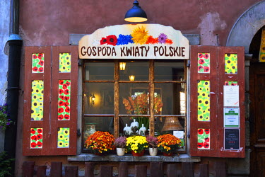 POL1612AW An old window in the Old Town Market Place (Rynek) in Warsaw, a Unesco World Heritage Site. Poland