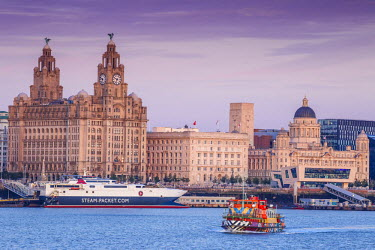 United Kingdom, England, Merseyside, Liverpool, Mersey ferry and Liverpool skyline - the only Dazzle ship in the UK