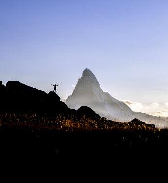 CLKRM27189 Hiker rejoices observing the Matterhorn from a panoramic location. Zermatt, Canton of Valais, Switzerland Europe
