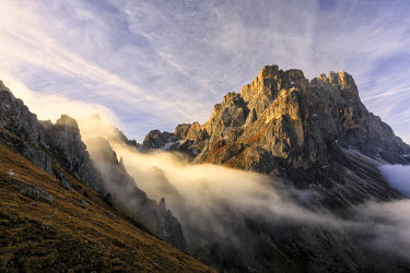 CLKRM28121 Low clouds and dawn lights on the peaks of Forcella De Furcia. Funes Valley South Tyrol Dolomites Italy Europe