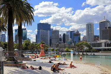 AUS2167 Streets Beach, an artificial sandy beach and swimming lagoon on Brisbane's South Bank, with views of the Birsbane River and the central business district beyond, Queensland, Australia