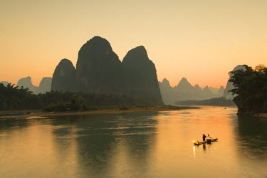 CH10536AW Cormorant fisherman on Li River at dusk, Xingping, Yangshuo, Guangxi, China