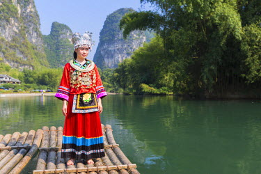 CH10556AW Woman wearing traditional clothes on Yulong River, Yangshuo, Guangxi, China (MR)