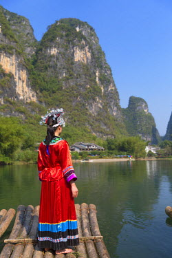 CH10558AW Woman wearing traditional clothes on Yulong River, Yangshuo, Guangxi, China (MR)