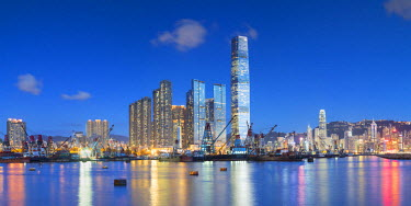 CH10595AW International Commerce Centre (ICC) and Yau Ma Tei Typhoon Shelter at dusk, West Kowloon, Hong Kong, China
