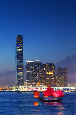 CH10626AW International Commerce Centre (ICC) and junk boat at dusk, Hong Kong, China