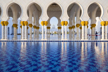 UAE0363AW United Arab Emirates, Abu Dhabi. The water pools of Sheikh Zayed Grand Mosque combine with the open colonnades to provide a significant cooling airflow through to the main courtyard.