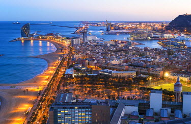ES02357 Elevated dusk view over Barcelona  beaches and seaport, Barcelona, Catalunya, Spain