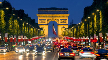 FR20053 View down the Champs Elysees to the Arc de Triomphe, illuminated at dusk, Paris, France