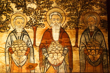 ROM1296 Romania, Maramures, Ieud. Abraham, Isaac and Joseph welcoming people in their arms, a painting in the old Wooden Church on the Hill.