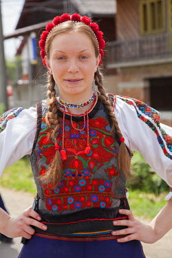 ROM1310 Romania, Maramures, Sieu. A young girl in traditional Maramures dress.