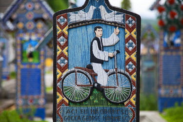 ROM1339 Romania, Maramures, Sapanta. The Merry Cemetery is famous for its colourful painted wooden grave markers carved with portraits of the deceased or scenes from their lives, with accompanying terse or wi...