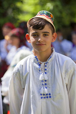 ROM1388 Romania, Maramures, Rozavlea. Young boy in traditional Maramures dress attending a blessing and ceremony in remembrance of war heroes.