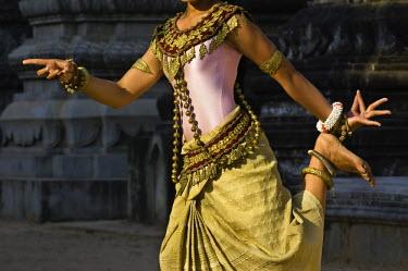 HMS0442054 Cambodia, Siem Reap Province, Siem Reap, Apsara dancer Sam Mealeas takes traditional dance position