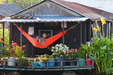 HMS0535829 Cambodia, Siem Reap Province, Tonle Sap Lake, Biosphere Reserve by UNESCO, Chong Khneas floating village, lake dwelling