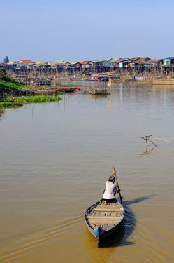 HMS2169784 Cambodia, Siem Reap province, Tonle Sap, Kompong Khleang, boat on the river with stilt houses