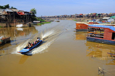 HMS2169785 Cambodia, Siem Reap province, Tonle Sap, Kompong Khleang, boat on the river with stilt houses