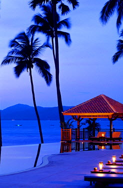 Thailand, Koh Samui, Maenam Beach, Napasai Beach Resort & Villas Hotel, swimming pool at nightfall