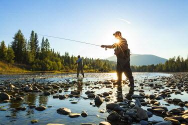 CA01203 Fly fisherman casting & fishing, British Coumbia, B.C., Canada